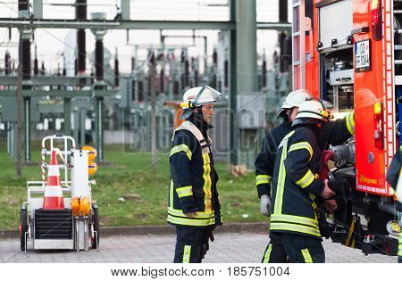 Hamburg, Germany - April 18, 2013: Hdr - Firefighter In Action On The Fire Truck