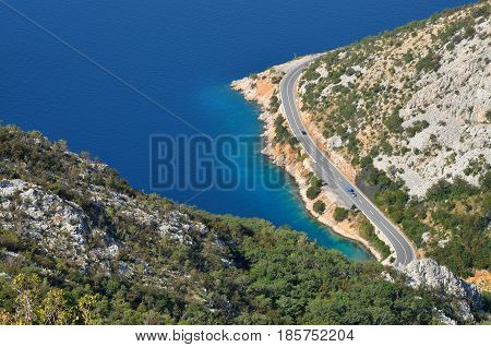 Aerial view of a winding coastal road near the Mediterranean sea