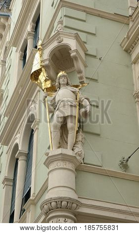 GRAZ, AUSTRIA - MARCH 19, 2017: Sculpture of Saint Florian on facade of building at Herrengasse street in Graz the capital of Styria.