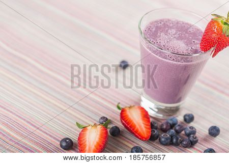 blueberry smoothie in a glass on the table