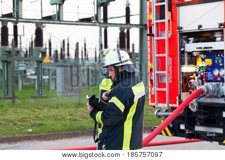 Hamburg, Germany - April 18, 2013: Hdr - Firefighter Chief In Action Near The Fire Engine