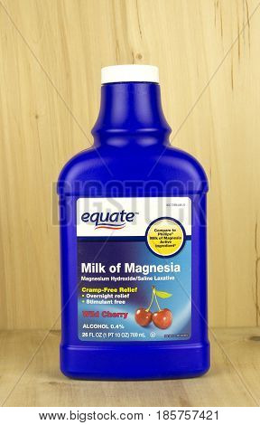 RIVER FALLS,WISCONSIN-MAY 10,2017: A bottle of Equate brand Milk of Magnesia with a wood background.