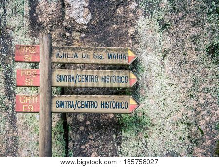 Wooden sign with arrows in  Sintra Portugal