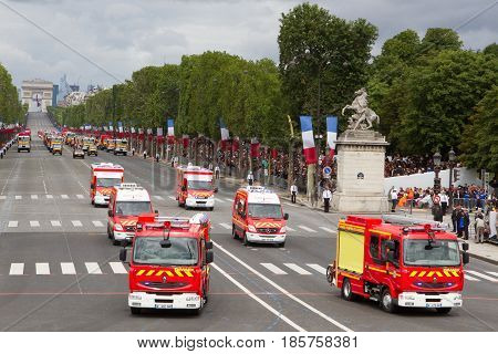 Paris France - July 14 2012. The procession of fire engines during the military parade in honor of the Bastille Day on the Champs Elysees in Paris.