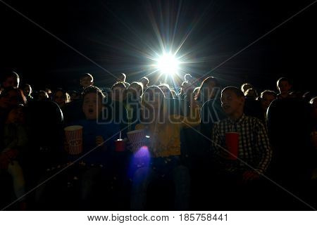 Shot of a dark cinema auditorium full of people enjoying watching a movie copyspace background humans many full darkness premiere film entertainment entertaining fun activity concept.