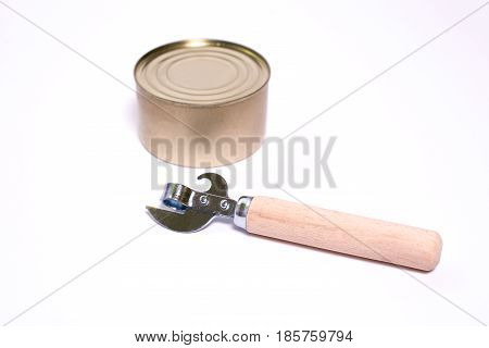 Vintage Can Opener With The Wooden Handle On A White Background With Space For Text