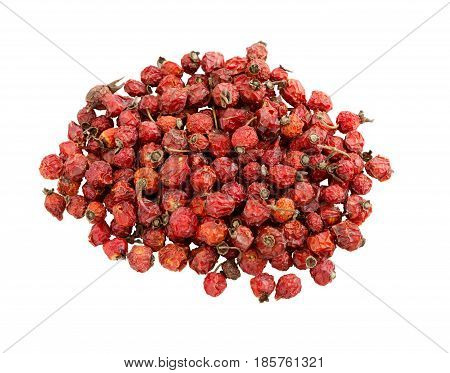 Dry berry Rose hips isolated on a white background. Dried rose hips. Pile of dogrose