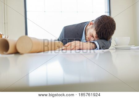 Stressed and exhausted businessman with burnout