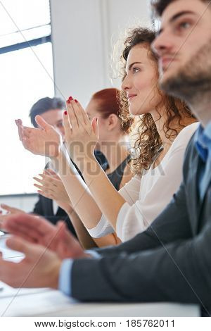 Business people applauding during seminar presentation