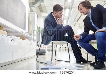 Two business people in dialogue during brainstorming