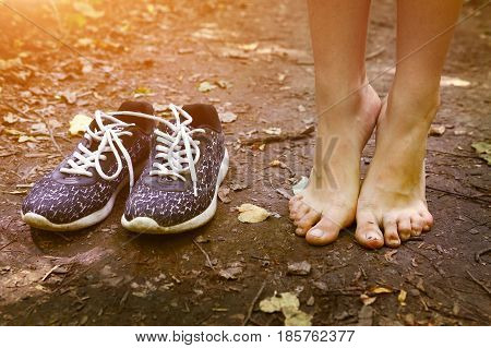 Bare Feet And Shoes On Forest Path