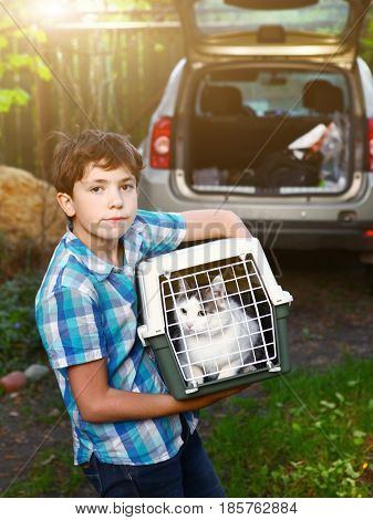 Country Boy With Cat In Carrier Going To Travel Car