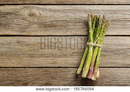 Fresh Green Asparagus On A Grey Wooden Table