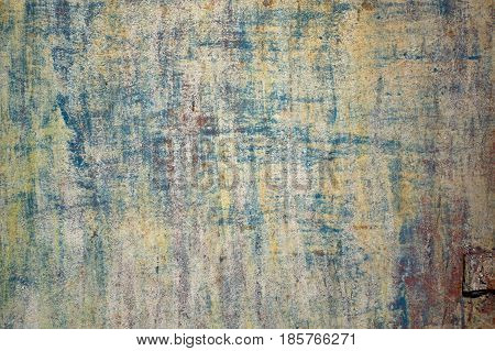 Multicolored Peeling Wall Texture And Background. Surface With Brush Strokes, Stains. The Colors Lik