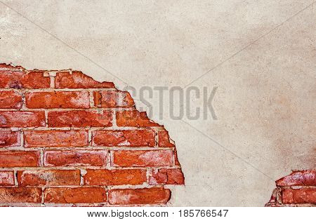 Half plastered brick wall. Half weathered brick wall a lot of copy space.Cracked wall. Aged architecture detail. Grunge brick wall half plastered.