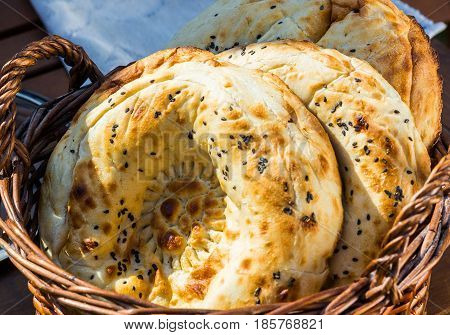 Homemade baked pita bread in a basket close-up selective focus