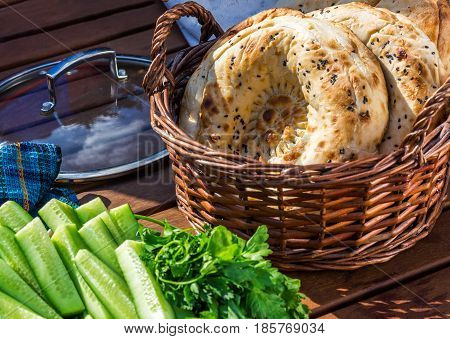 Homemade baked pita bread in a basket close-up vegetables selective focus