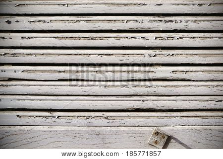 The close up of an old wooden and fading wooden jalousie