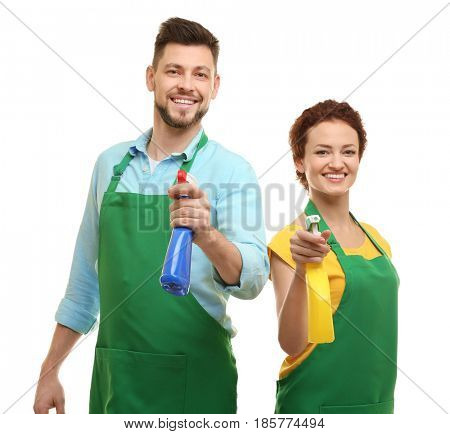 Couple with detergents on white background