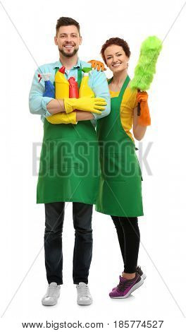 Couple with cleaning supplies on white background
