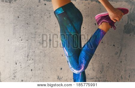 Fitness athletes foot close-up. Healthy lifestyle and sport concepts. Woman in fashionable sportswear is doing exercise. poster