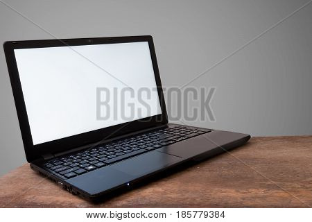 Labtop and Mockup Copyspace Concept Gray background.