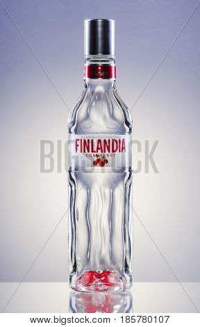 Finlandia natural flavoured cranberry vodka on gradient background. Finlandia vodka has been produced from barley and pure glacier water since 1970.