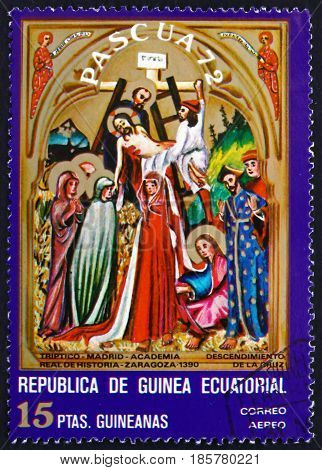 EQUATORIAL GUINEA - CIRCA 1972: a stamp printed in Equatorial Guinea shows Descent from the Cross Easter Detail from Triptych circa 1972