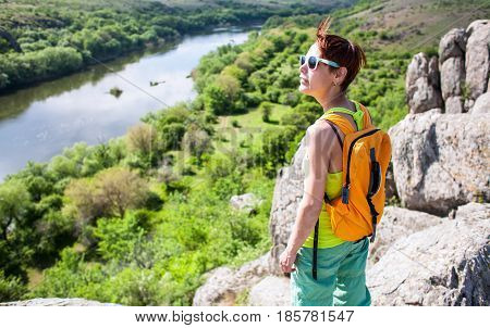 Girl With A Backpack Walks In Picturesque Places.