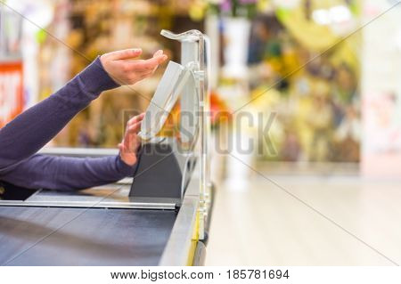 Closeup of a Cashier at Checkout Counter in a Supermarket