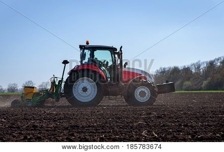 Varna Bulagria - April 01 2017. Big Steyr tractor with attached Great Plains seeder for sunflower seeds. Agriculture tractor sowing seeds and cultivating field.