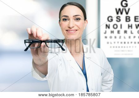 Oculist showing eyeglasses