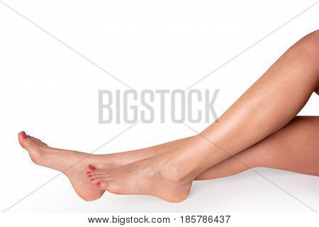 Female slender beautiful legs isolated on white background