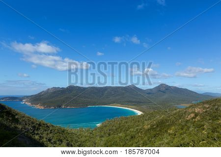 View over turquoise waters of Wineglass Bay, Tasmania's famous east coast in Freycinet National Park, Tasmania island, Australia