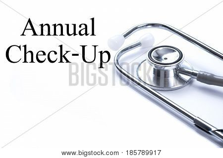 Page with Annual Check-Up on the table with stethoscope medical concept.