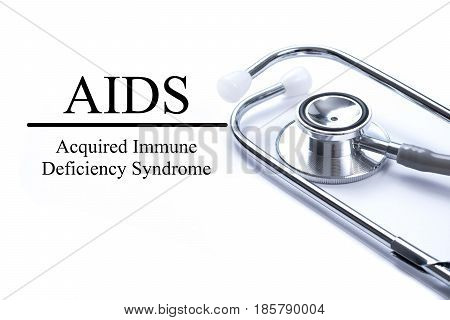 Page with AIDS (Acquired Immune Deficiency Syndrome) on the table with stethoscope medical concept