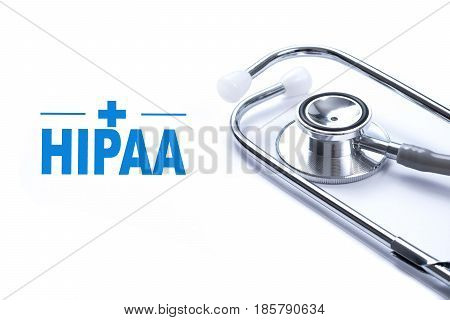 Page with HIPAA (The Health Insurance Portability and Accountability Act of 1996) on the table with stethoscope medical concept