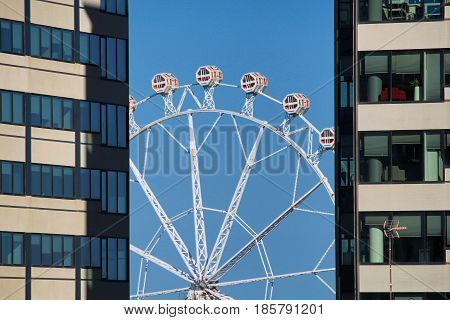 BARCELONA/SPAIN - 1 MAY 2017: Carousel between two skyscrapers at Barcelona's Feria de Abril near Forum
