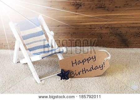 Sunny Summer Label With Sand And Aged Wooden Background. English Text Happy Birthday. Deck Chair For Holiday Or Vacation Feeling.