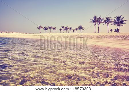 Vintage Toned Pristine Beach With Crystal Clear Water.