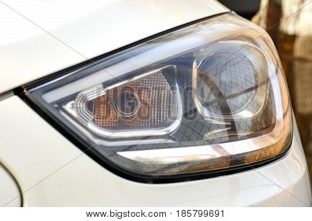 white Car headlights. Exterior detail automobile close-up