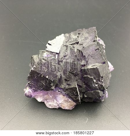a large chunk of purple fluorite with lots of obvious squares