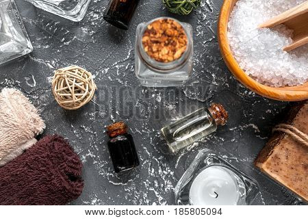 Aromatherapy SPA set with salt and natural oil on dark desk background top view