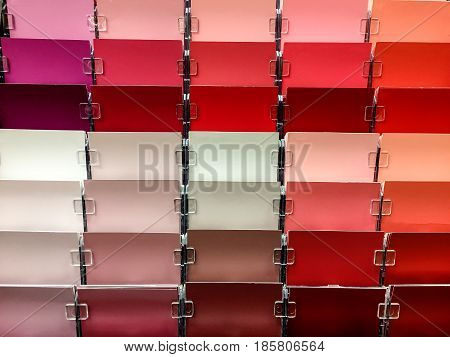 Paint.Paint concept. Paint samples. Red color paint in different texture. Store wall paint samples. Paint selection for painters.