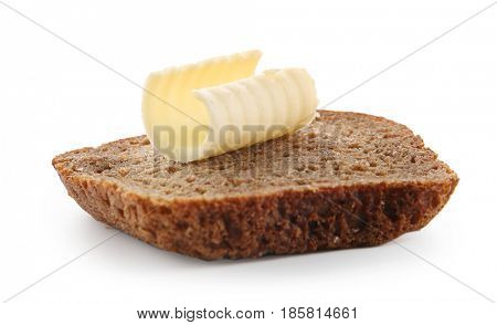 Slice of bread with butter curl on white background