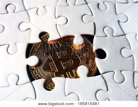 golden  bitcoin coin under puzzle. Business concept.