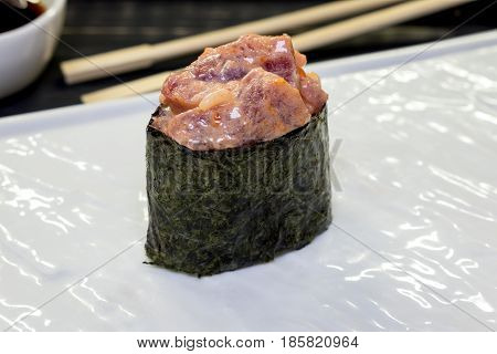 Gunkan with fresh tuna on a white plate