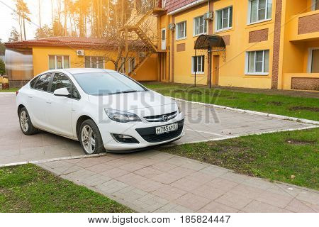 Smolensk, Russia - April ,25 2017: New Opel Astra parked near house on the street of Smolensk City.