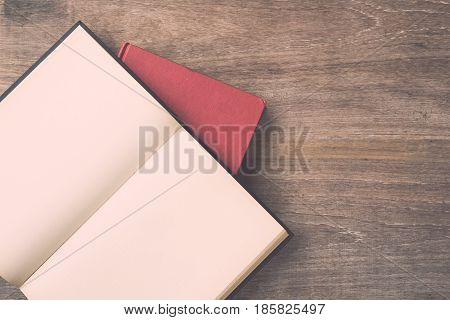 Old Book On Wooden Plank Background