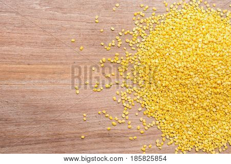 Peeled Mung Beans Put On Wooden Plank Background